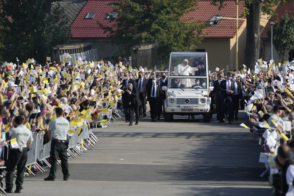 Pope Francis arrives on his pope-mobile to celebrate a Byzantine rite Mass at Mestska sportova hala Square, in Presov, Slovakia, Tuesday, Sept. 14, 20...