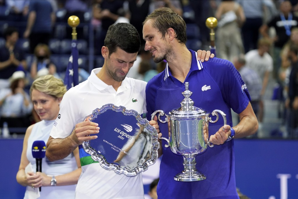 Daniil Medvedev, of Russia, right, talks with Novak Djokovic, of Serbia, after defeating Djokovic in the men's singles final of the US Open tennis cha...