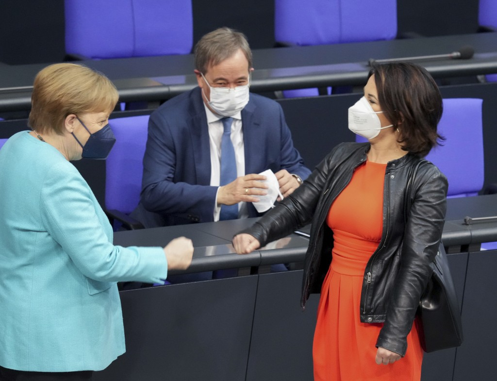 FILE - In this Thursday June 24, 2021 file photo,German Chancellor Angela Merkel, left, welcomes the top candidates for the upcoming national election...