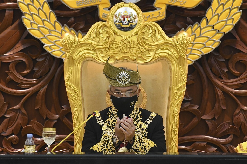 In this photo released by Malaysia's Department of Information, Malaysia's King Sultan Abdullah Sultan Ahmad Shah prays during the opening ceremony of...