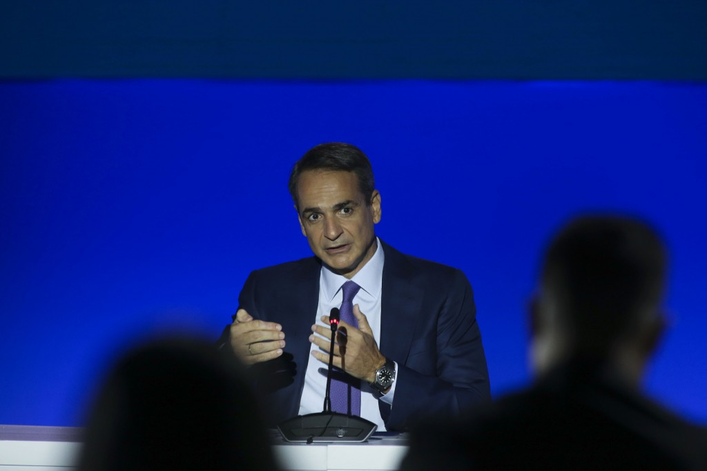 Greece's Prime Minister Kyriakos Mitsotakis addresses reporters during a news conference at the Thessaloniki International Fair, in the northern city ...