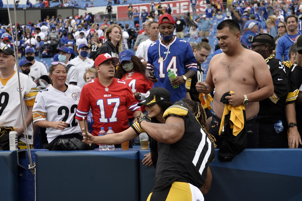 Pittsburgh Steelers wide receiver Chase Claypool (11) poses for a photo with a fan after a win over the Buffalo Bills in an NFL football game in Orcha...