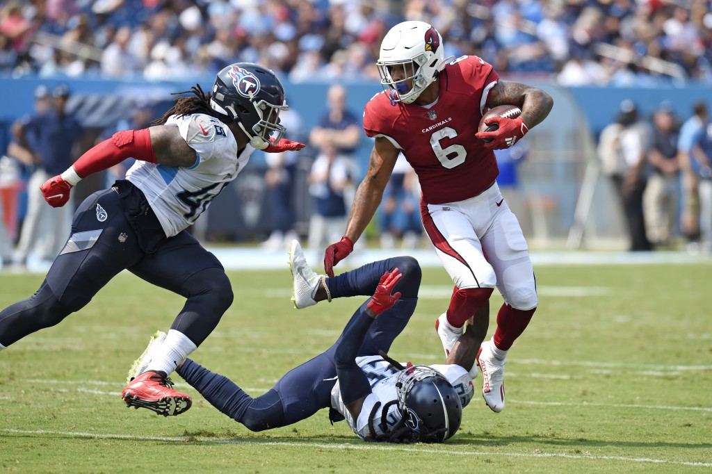 Arizona Cardinals running back James Conner (6) carries the ball against Tennessee Titans outside linebacker Bud Dupree (48) and cornerback Jackrabbit...