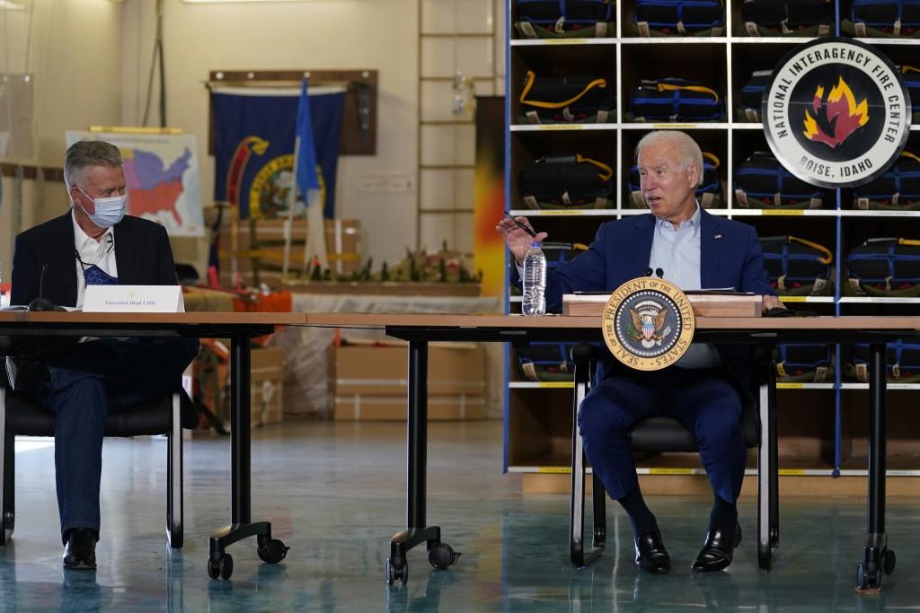 President Joe Biden speaks during a visit to the National Interagency Fire Center, Monday, Sept. 13, 2021, in Boise, Idaho, as Idaho Gov. Brad Little ...
