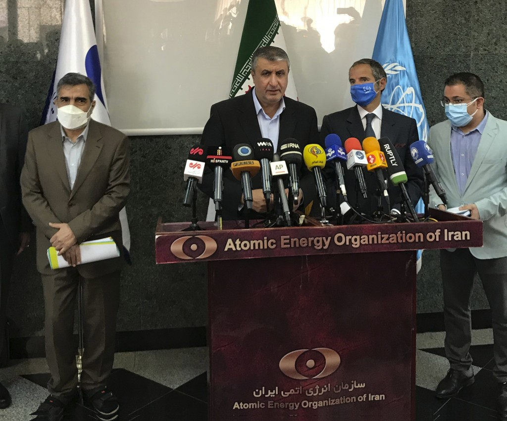 Head of Atomic Energy Organization of Iran, Mohammad Eslami, center, speaks during a joint press briefing with Director General of International Atomi...
