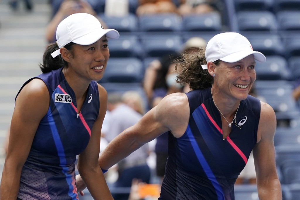 Shual Zhang, of China, left, and Samatha Stosur, of Australia, celebrate after defeating Coco Gauff and Catherine McNally, both of the United States, ...