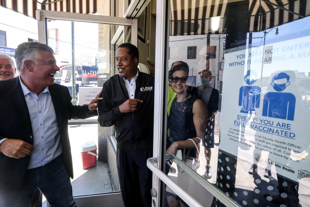 Republican conservative radio show host Larry Elder, second from left, and former Lt. Gov. Abel Maldonado, left, leave after they visiting Philippe Th...