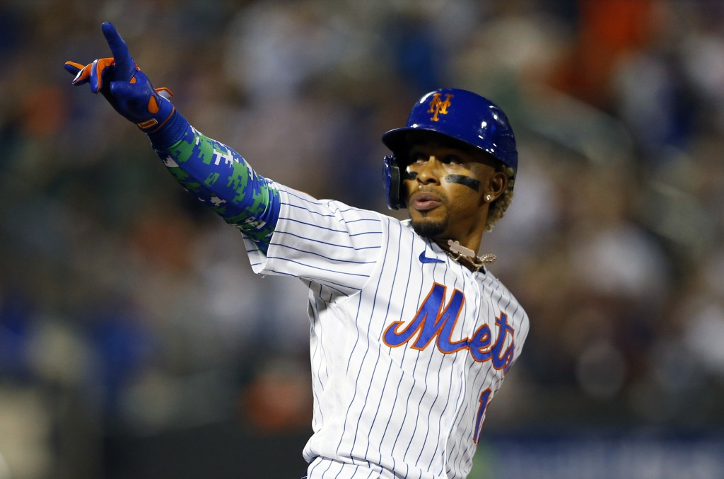 New York Mets' Francisco Lindor reacts after hitting a home run against the New York Yankees during the second inning of a baseball game on Sunday, Se...