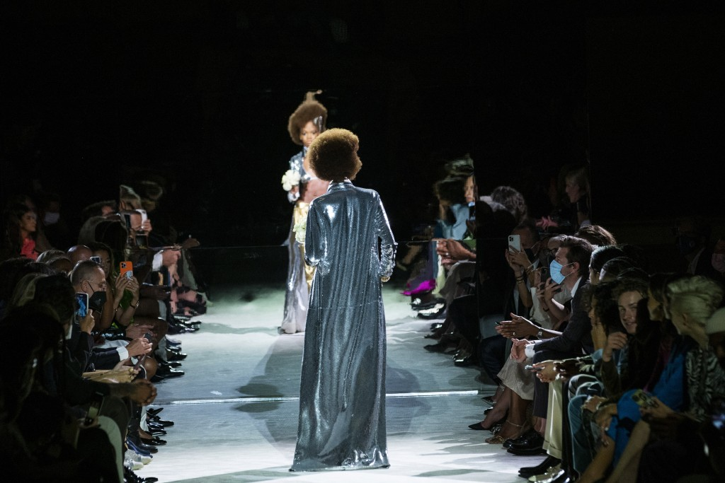 Models walk the runway at the Tom Ford spring/summer 2022 fashion show at Lincoln Center during New York Fashion Week on Sunday, Sept. 12, 2021. (AP P...