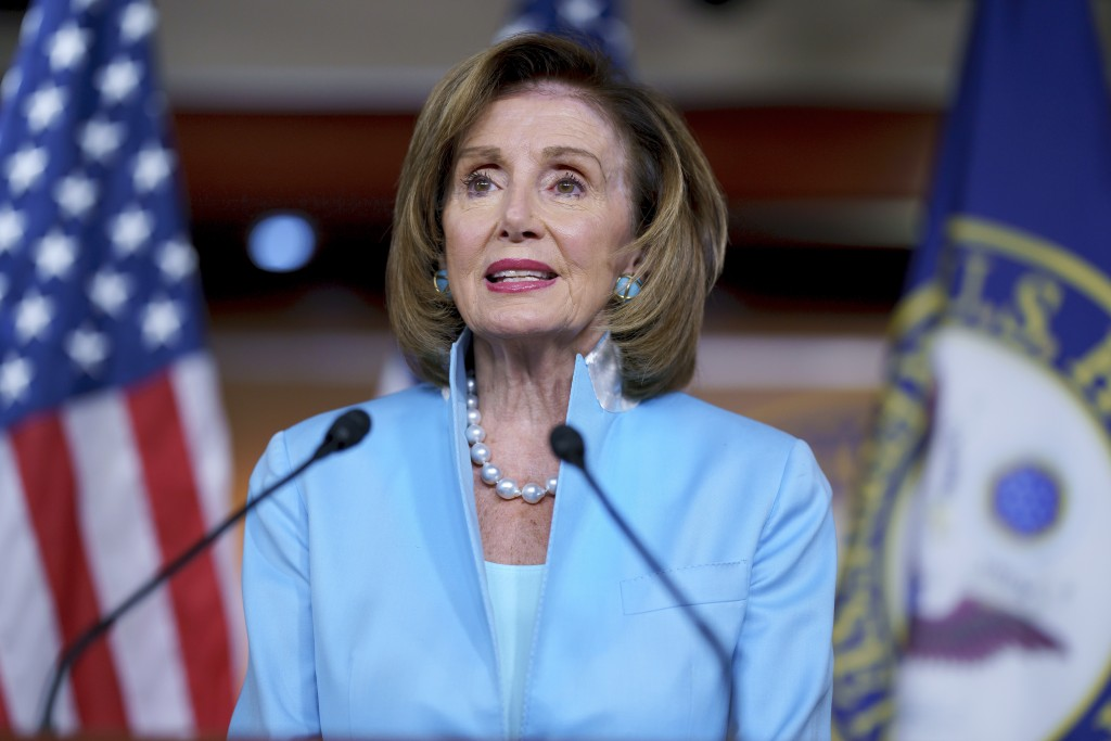 FILE - In this Aug. 6, 2021, file photo, Speaker of the House Nancy Pelosi, D-Calif., meets with reporters at the Capitol in Washington. The campaign ...