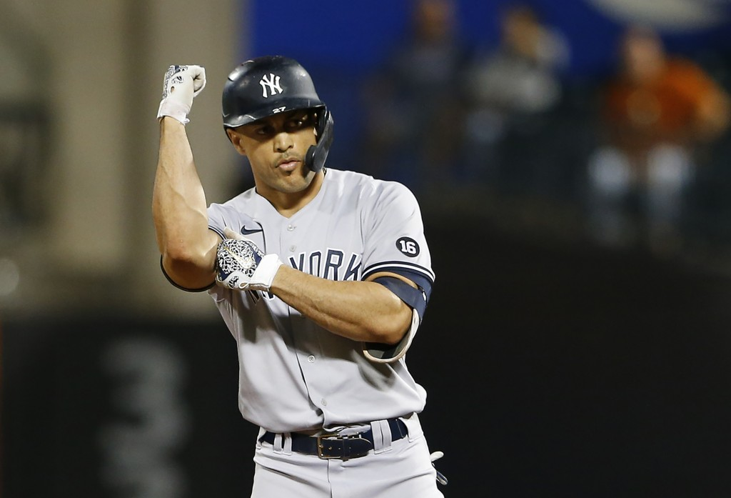 New York Yankees's Giancarlo Stanton reacts after hitting a double against the New York Mets during the first inning of a baseball game on Sunday, Sep...