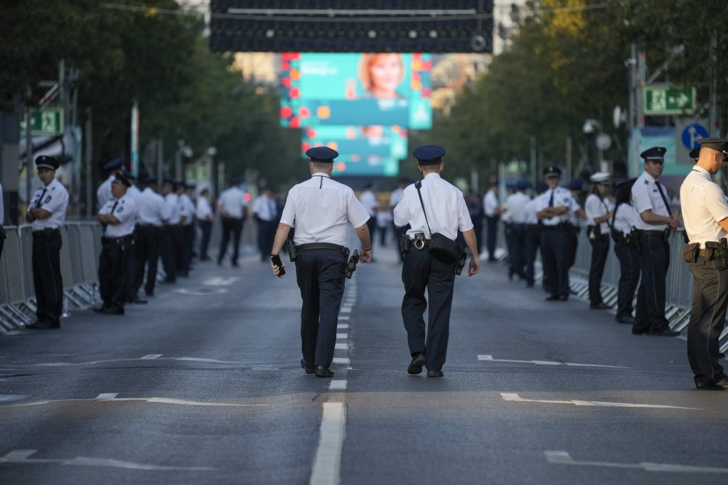 Police officers patrol the streets around Heroes' Square prior to the arrival of Pope Francis to celebrate mass, Budapest, Sunday, Sept. 12, 2021. Fra...