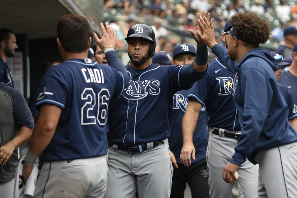 Tampa Bay Rays designated hitter Nelson Cruz, center, is congratulated by teammates after scoring a run on a ground out by Kevin Kiermaier off Detroit...