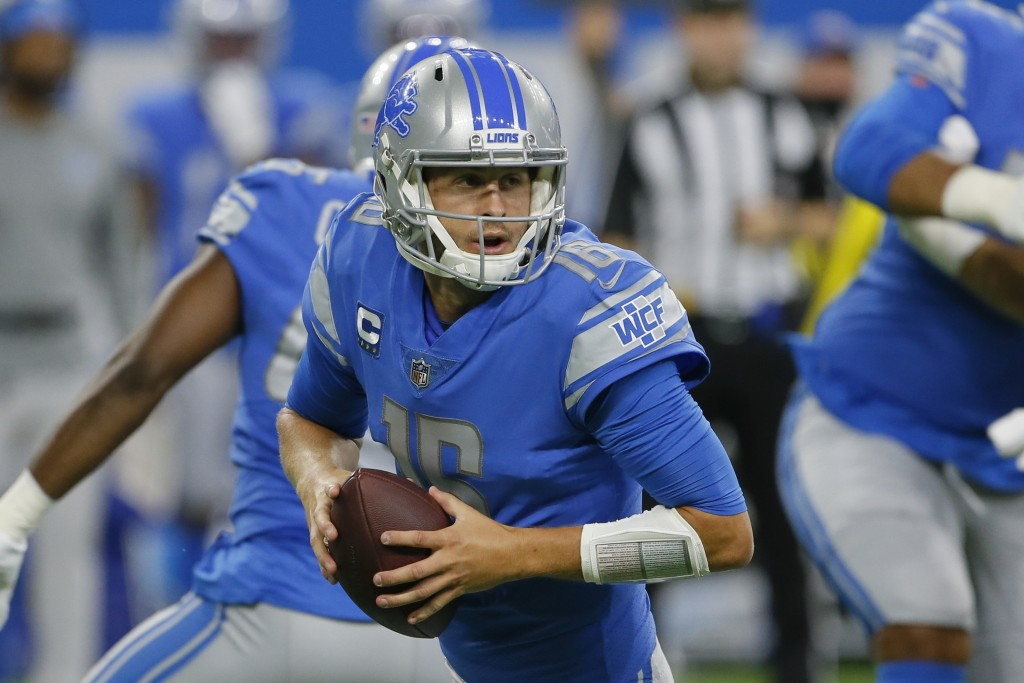 Detroit Lions quarterback Jared Goff rolls out to pass against the San Francisco 49ers In the first half of an NFL football game in Detroit, Sunday, S...