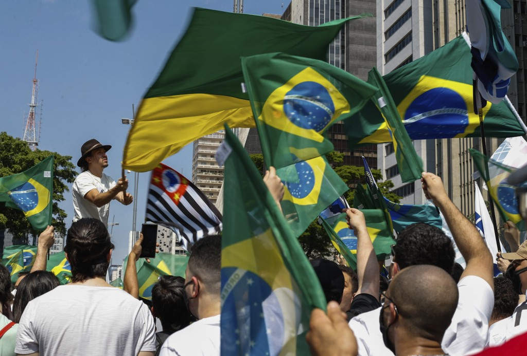 People hold Brazilian flags during a protest against President Jair Bolsonaro, demanding his resignation for mishandling the pandemic, corruption over...