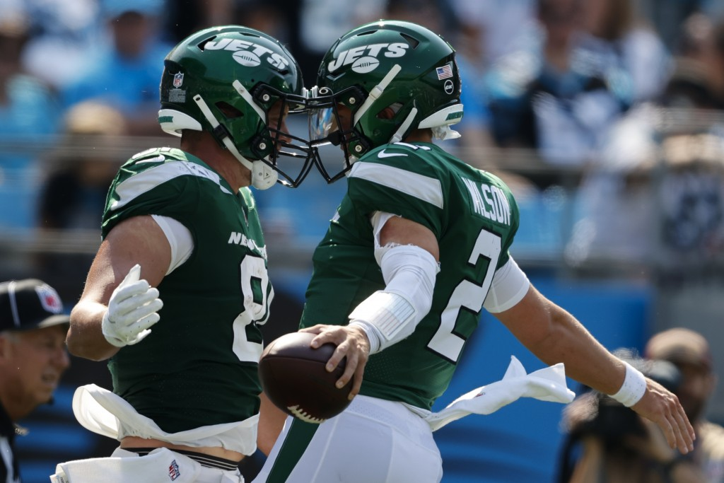 New York Jets quarterback Zach Wilson celebrates after scoring a 2-point conversion with Tyler Kroft against the Carolina Panthers during the second h...