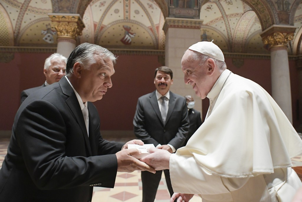 Pope Francis exchanges gifts with Hungarian Prime Minister Viktor Orban, at Budapest's Museum of Fine Arts, Sunday, Sept. 12, 2021. Francis is opening...