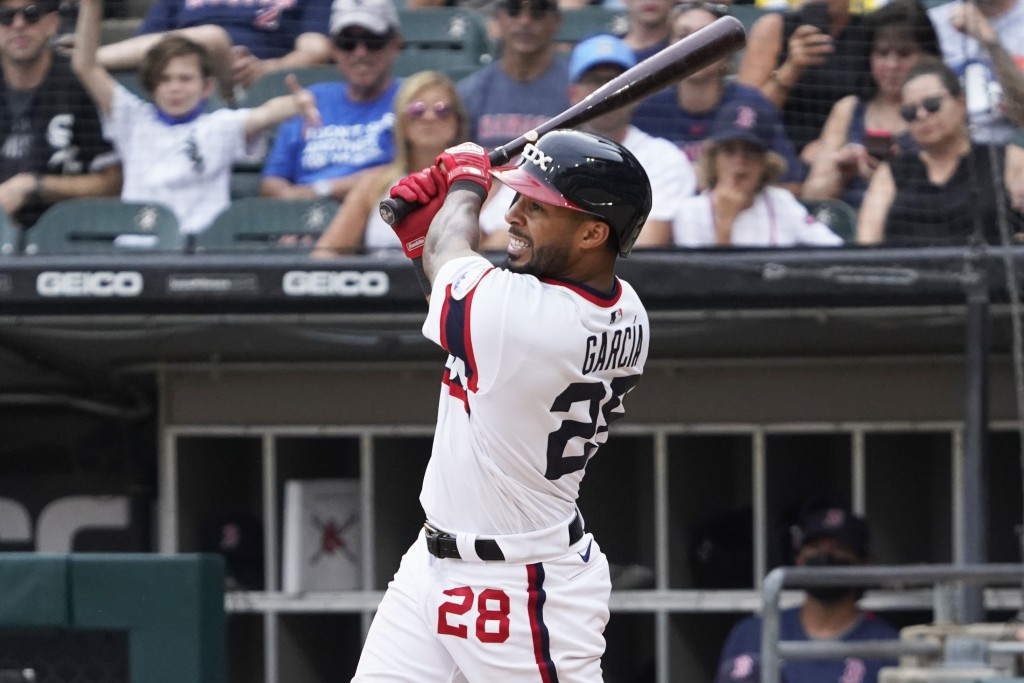 Chicago White Sox' Leury Garcia (28) hits a walk-off home run during the ninth inning against the Boston Red Sox in a baseball game, Sunday, Sept. 12,...