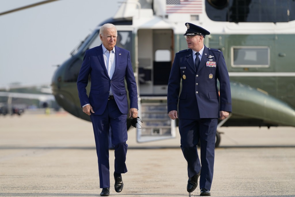 President Joe Biden arrives to board Air Force One for a trip to visit the National Interagency Fire Center in Boise, Idaho, Monday, Sept. 13, 2021, i...