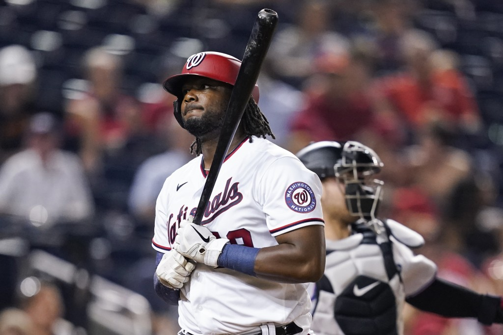 Washington Nationals' Josh Bell reacts after striking out during the fifth inning of a baseball game against the Washington Nationals at Nationals Par...