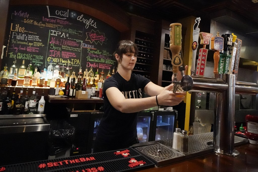 Shalia McCall fills drink orders at Puckett's Grocery and Restaurant, Friday, Sept. 10, 2021, in Nashville, Tenn. In Nashville, tourism has come back ...