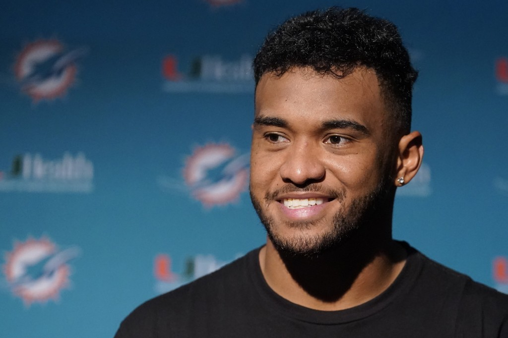 Miami Dolphins quarterback Tua Tagovailoa smiles during a news conference after a win over the New England Patriots in an NFL football game, Sunday, S...