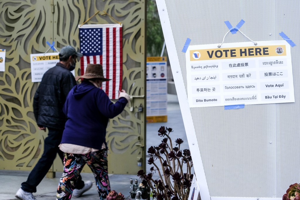 Voters arrive to cast their ballots at the Lincoln Park Senior Center in Los Angeles, Tuesday, Sept. 14, 2021. The recall election that could remove C...