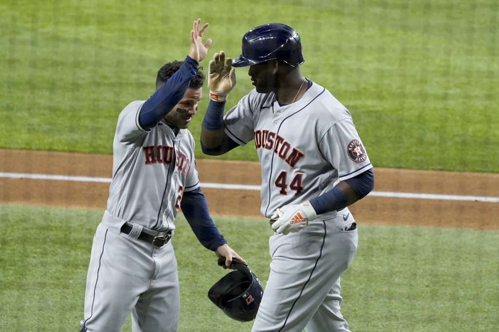 Houston Astros' Jose Altuve, left, and Yordan Alvarez celebrate a two run-home run hit by Alvarez in the second inning of a baseball game against the ...