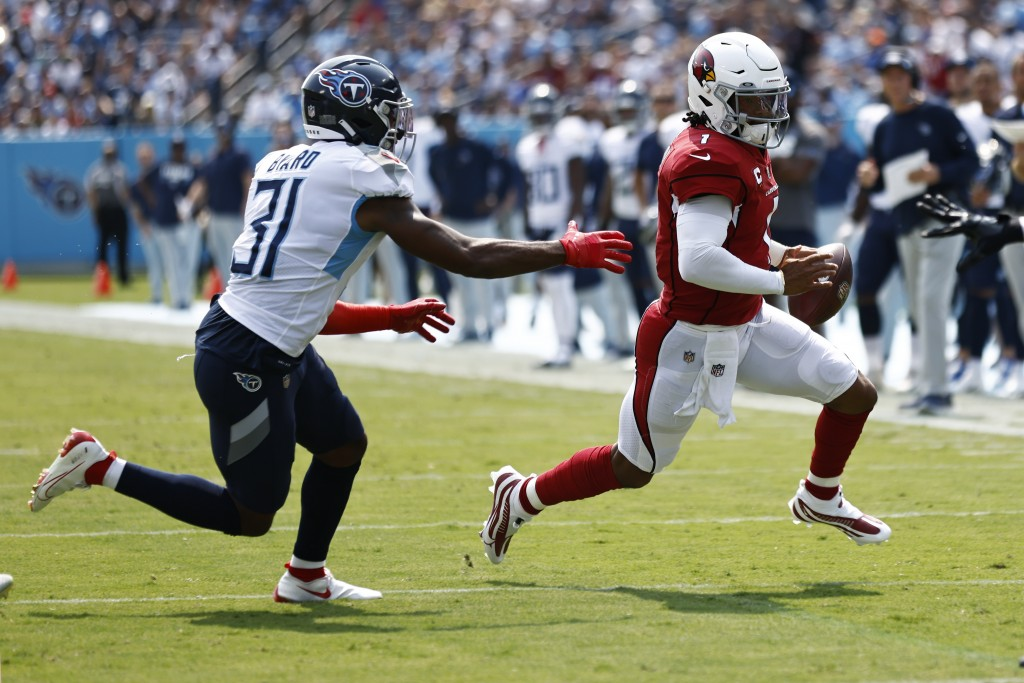 Arizona Cardinals quarterback Kyler Murray (1) scrambles away from Tennessee Titans free safety Kevin Byard (31) in the first half of an NFL football ...