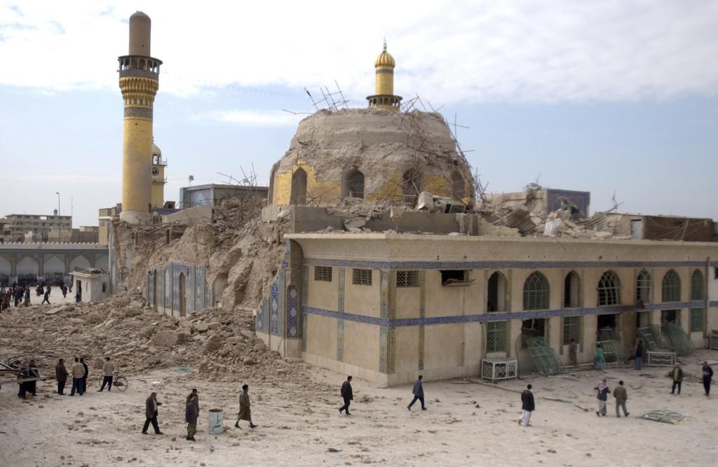 FILE - In this Feb. 22, 2006, file photo, Iraqis walk past the damaged Askariya shrine following an explosion in Samarra, north of Baghdad. (AP Photo/...