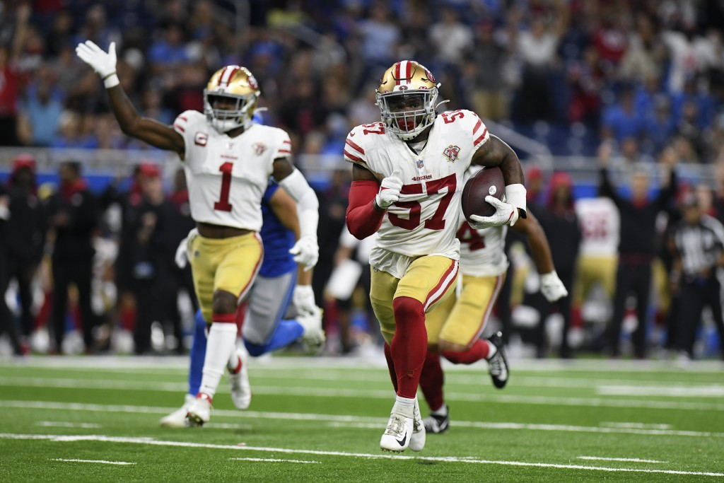 San Francisco 49ers linebacker Dre Greenlaw (57) returns an interception for a 39-yard touchdown against the Detroit Lions in the first half of an NFL...