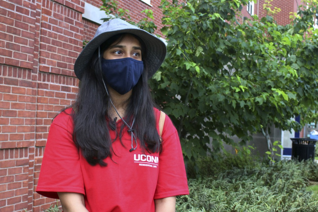 UConn sophomore Sahiti Bhyravavajhala assists students moving into Shippee Hall on the Storrs, Conn. campus, Friday, Aug. 27, 2021. UConn is one of ma...