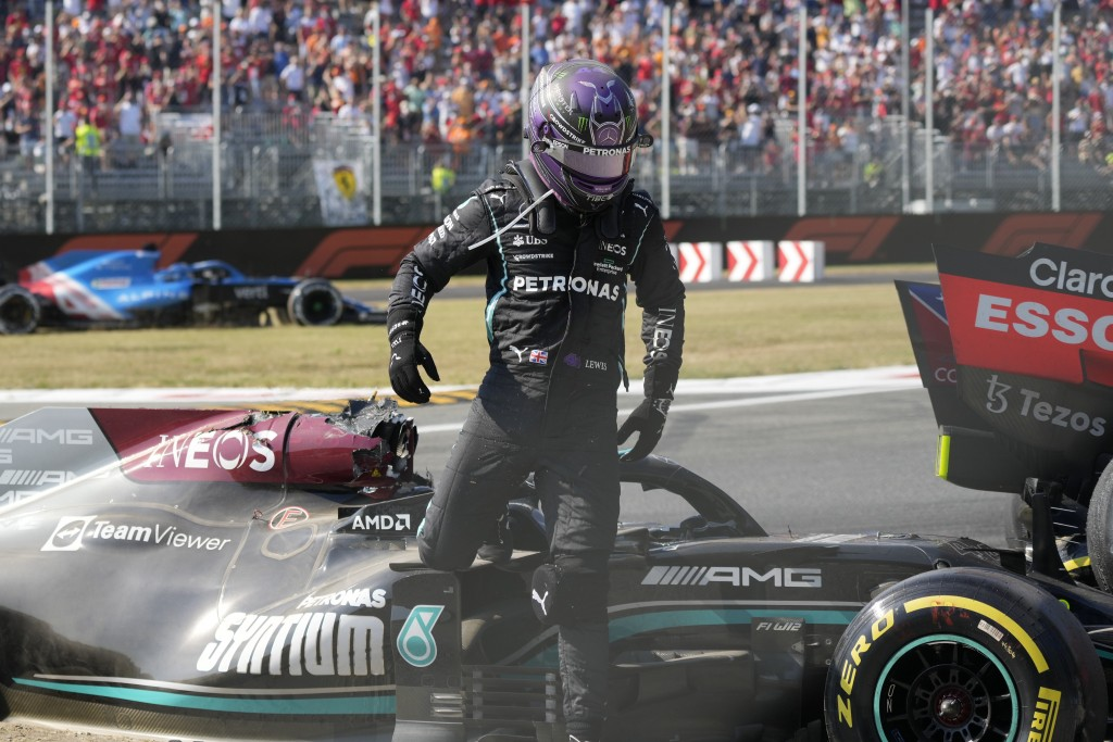 Mercedes driver Lewis Hamilton of Britain leaves his car after crashing with Red Bull driver Max Verstappen of the Netherlands during the Italian Form...