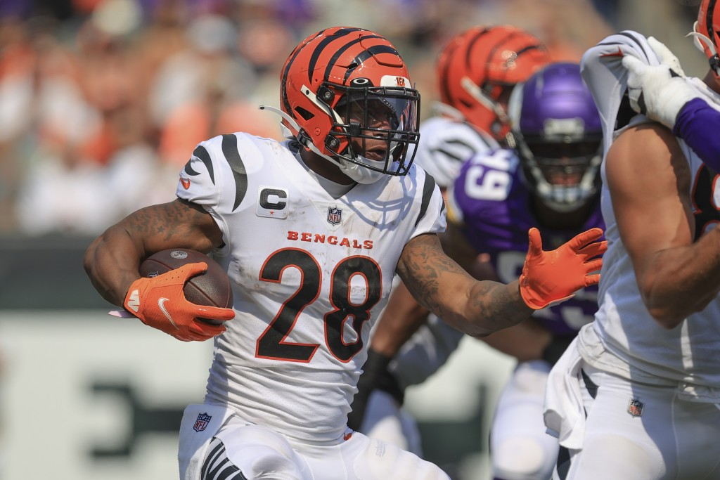 Cincinnati Bengals running back Joe Mixon (28) runs against the Minnesota Vikings during the second half of an NFL football game, Sunday, Sept. 12, 20...