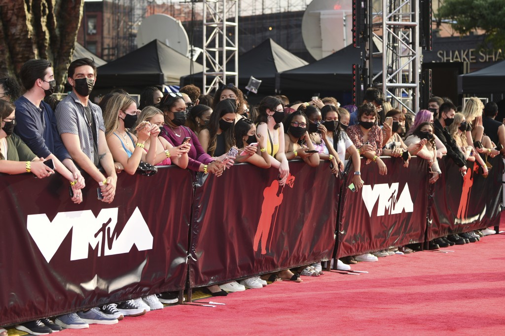 Fans wearing masks line up along the red carpet at the MTV Video Music Awards at Barclays Center on Sunday, Sept. 12, 2021, in New York. (Photo by Eva...