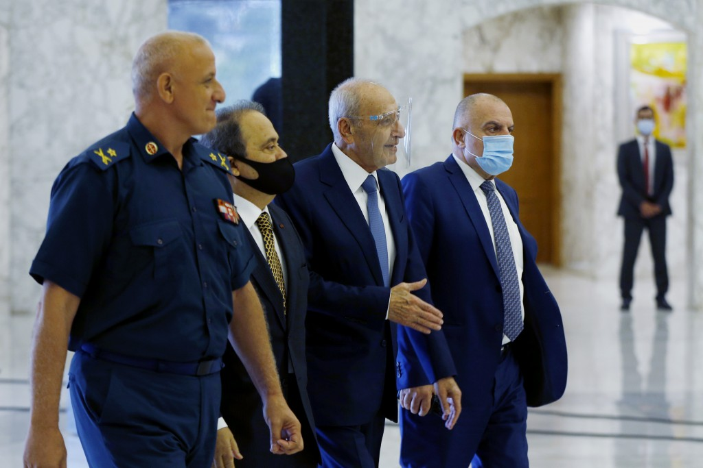Lebanese Parliament Speaker Nabih Berri, center, arrives to attend a cabinet meeting at the presidential palace in Baabda, east of Beirut, Lebanon, Mo...