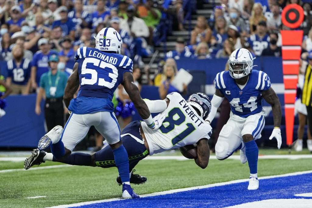 Seattle Seahawks tight end Gerald Everett (81) scores a touchdown between Indianapolis Colts outside linebacker Darius Leonard (53) and outside lineba...