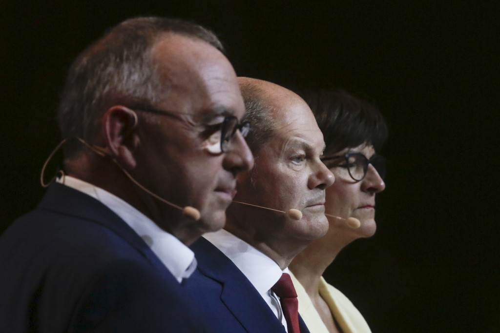 FILE - In this Aug. 10, 2020 file photo, German Finance Minister and chancellor candidate Olaf Scholz, center, and the Social Democratic Party leaders...