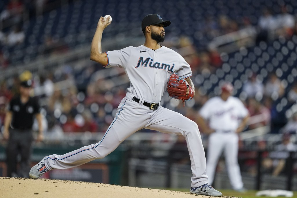 Miami Marlins starting pitcher Sandy Alcantara throws during the first inning of a baseball game against the Washington Nationals at Nationals Park, M...