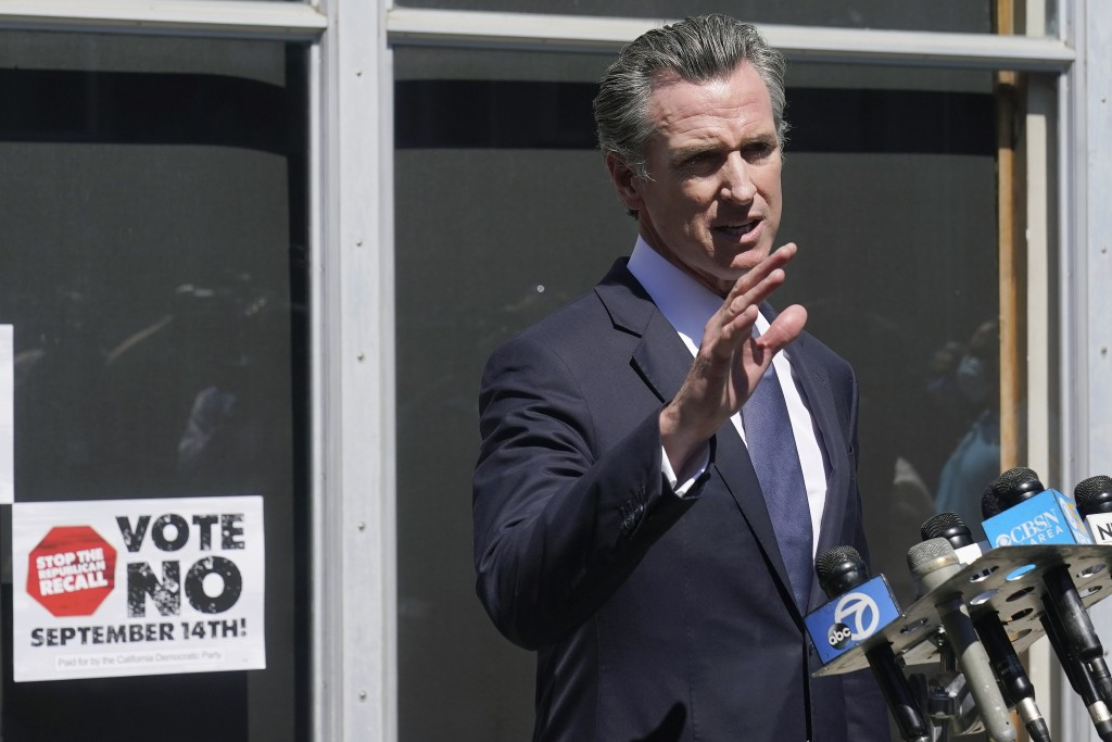 Gov. Gavin Newsom speaks to reporters in San Francisco, Tuesday, Sept. 14, 2021. The recall election that could remove California Democratic Gov. News...