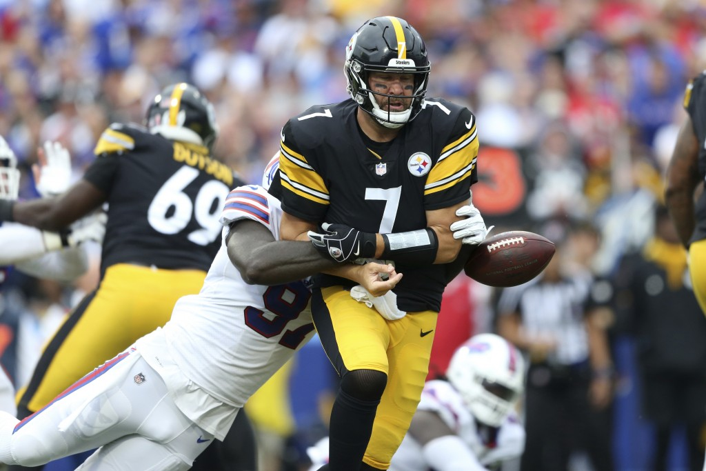 Buffalo Bills defensive end Mario Addison (97) strips the ball from Pittsburgh Steelers quarterback Ben Roethlisberger (7) during the first half of an...