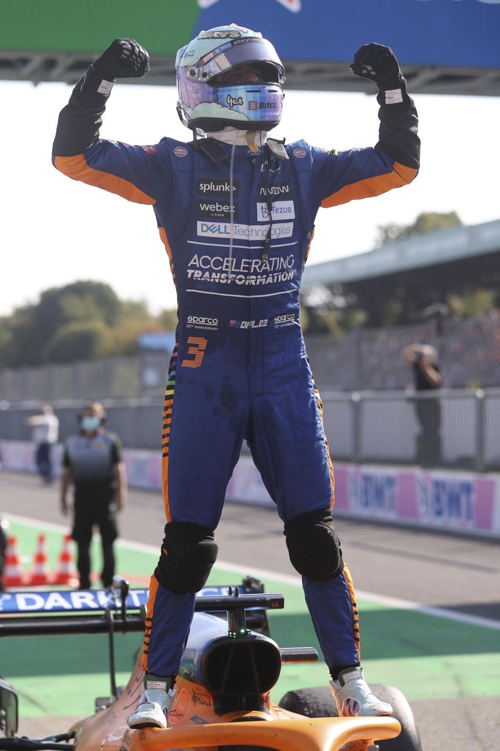 Mclaren driver Daniel Ricciardo of Australia celebrates after winning the Italian Formula One Grand Prix, at Monza racetrack, in Monza, Italy, Sunday,...