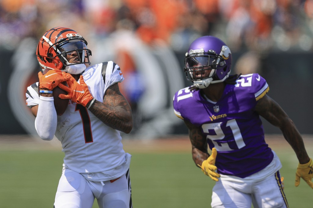 Cincinnati Bengals wide receiver Ja'Marr Chase (1) makes a catch past Minnesota Vikings defensive back Bashaud Breeland (21) and takes it in for a tou...