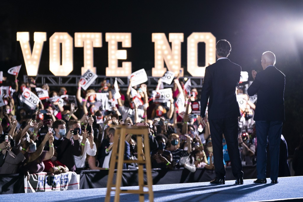 President Joe Biden stands with Gov. Gavin Newsom, D-Calif., during a campaign rally at at Long Beach City College, Monday, Sept. 13, 2021, in Long Be...