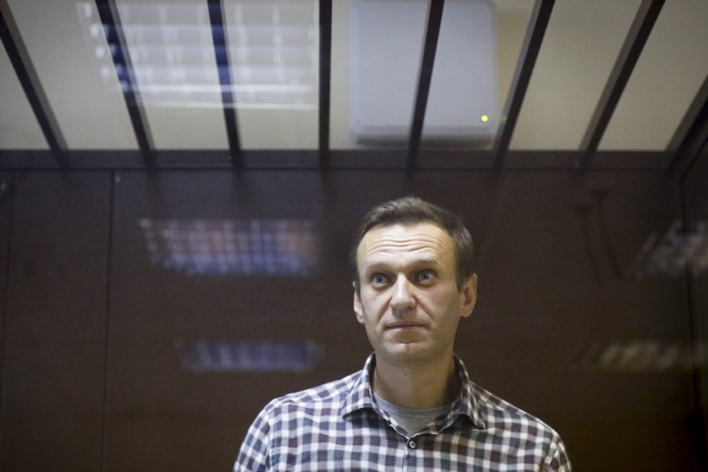 FILE - In this Feb. 20, 2021, file photo, Russian opposition leader Alexei Navalny stands in a cage in the Babuskinsky District Court in Moscow, Russi...