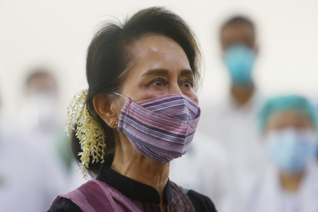 FILE - In this Jan. 27, 2021, file photo, Myanmar leader Aung San Suu Kyi watches the vaccination of health workers at a hospital in Naypyitaw, Myanma...