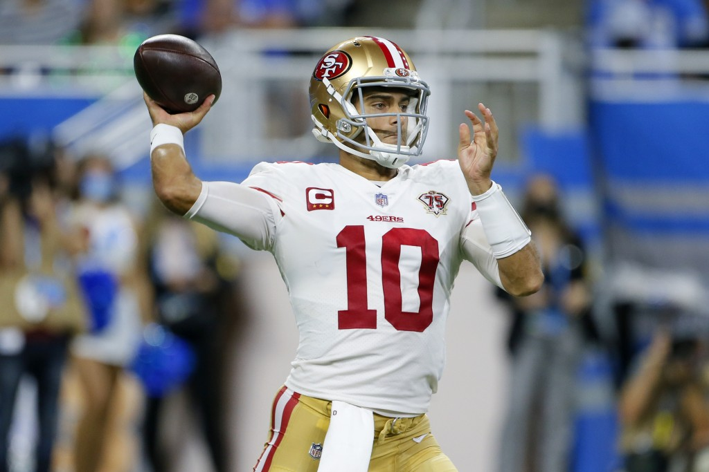 San Francisco 49ers quarterback Jimmy Garoppolo throws against the Detroit Lions in the second half of an NFL football game in Detroit, Sunday, Sept. ...