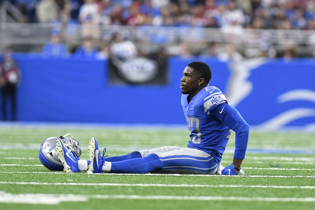 Detroit Lions cornerback Jeff Okudah sits on the field after being injured against the San Francisco 49ers in the second half of an NFL football game ...