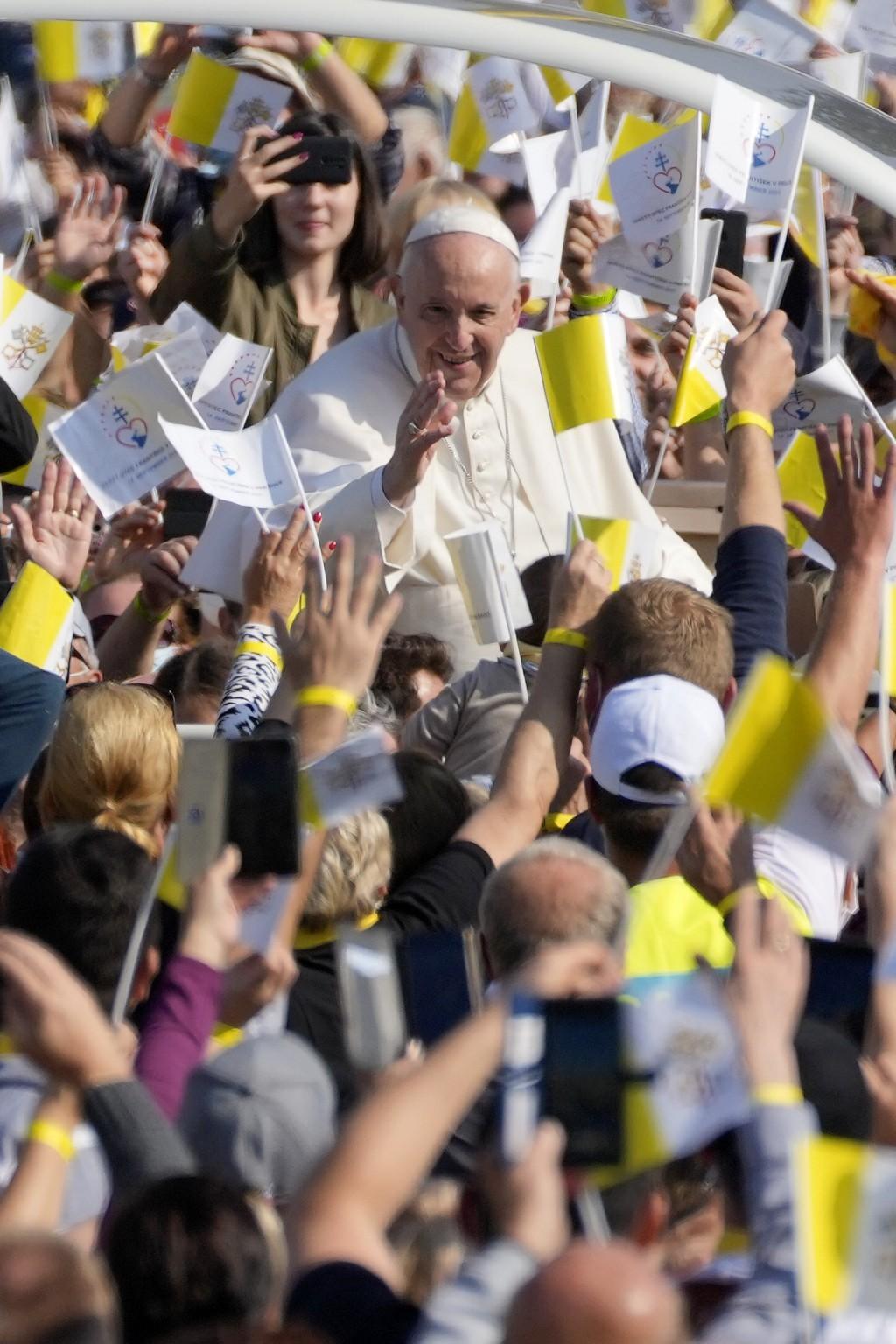 Pope Francis blesses faithful as he arrives on his pope-mobile to celebrate a Byzantine rite Mass at Mestska sportova hala Square, in Presov, Slovakia...