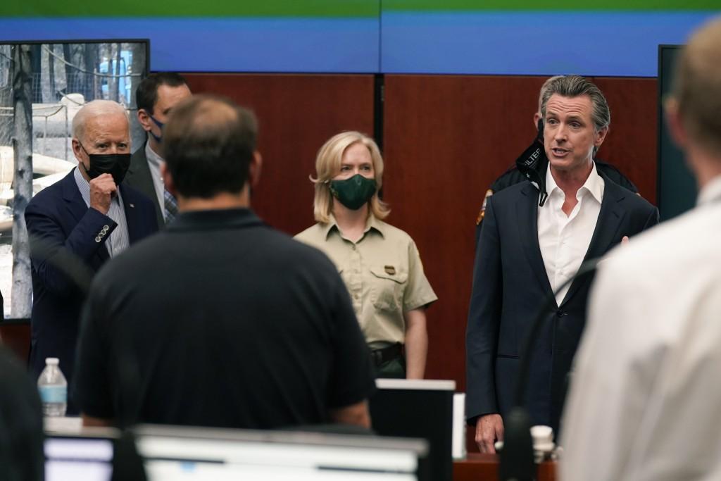 President Joe Biden listens as California Gov. Gavin Newsom speaks during a briefing on wildfires at the California Governor's Office of Emergency Ser...